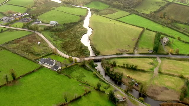 aerial views of the border between northern ireland and the republic of ireland - 北アイルランド点の映像素材/bロール