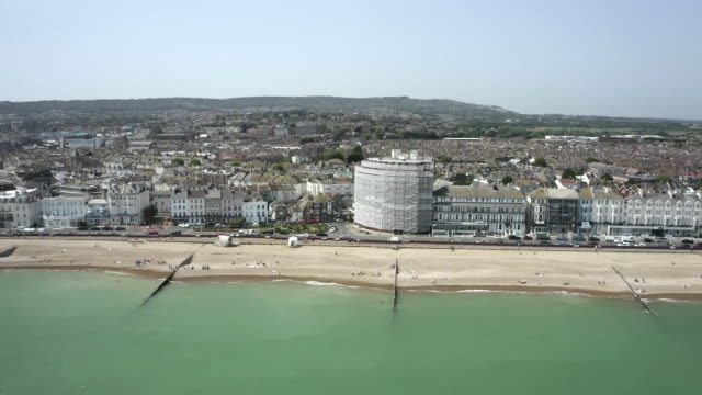 aerial views of the eastbourne coast - east sussex stock videos & royalty-free footage