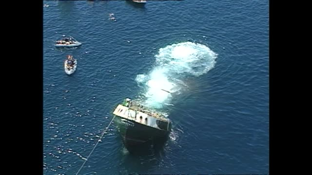 Aerial views of the Greenpeace vessel Rainbow Warrior being scuttled