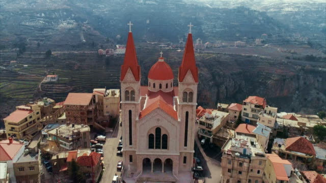 Aerial views of the hilltop town of Bsharri and surrounding landscape in the Qadisha Valley in Lebanon