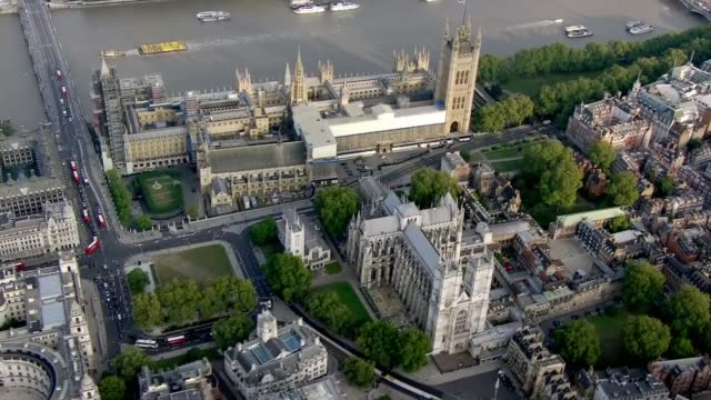 aerial views of the houses of parliament; england: london: ext aerial / air view houses of parliament, westminster and whitehall / track over central... - other stock videos & royalty-free footage