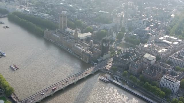 aerial views of the houses of parliament england london westminster houses of parliament the river thames british flag above victoria tower - victoria tower stock videos & royalty-free footage