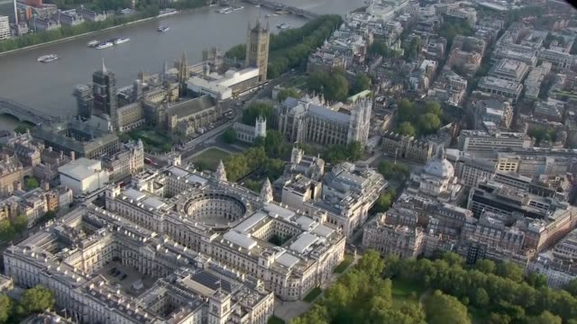 aerial views of the houses of parliament england london westminster houses of parliament and the river thames british flag above victoria tower... - victoria tower stock videos & royalty-free footage