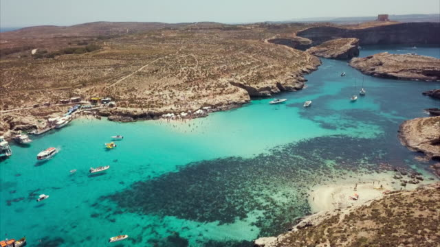 Aerial views of the Maltese coast with clear turquoise waters
