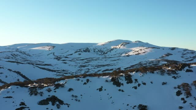 aerial views of the mountain range of snowy mountains in news south wales, australia on september 14, 2020 - snowcapped mountain stock videos & royalty-free footage