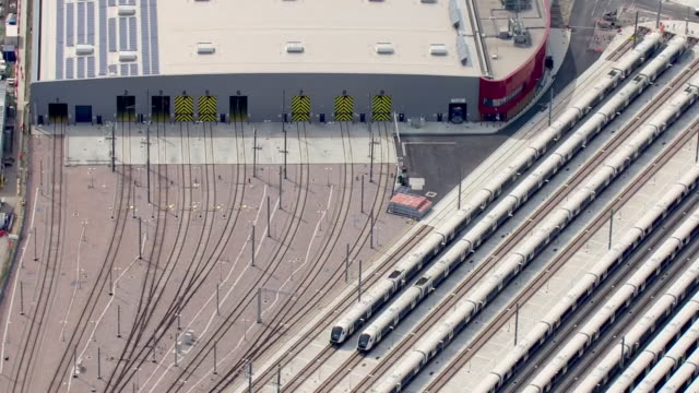 aerial views of the old oak common railway depot site of the the planned old oak common hs2 railway station and super hub connection with crossrail... - connection stock videos & royalty-free footage