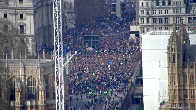 aerial views of the people's vote march through london - marching stock videos & royalty-free footage