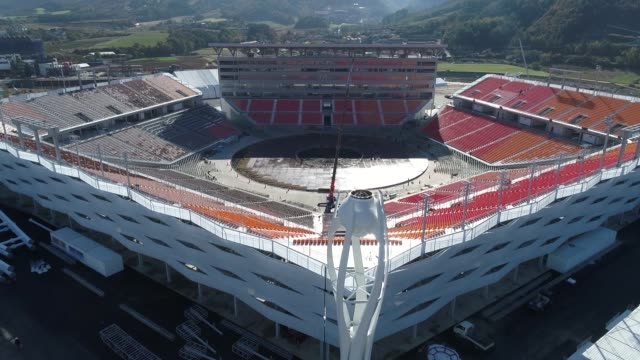 aerial views of the pyeongchang olympic stadium the venue for the opening and closing ceremonies at the 2018 pyeongchang winter olympic games taken... - オリンピックスタジアム点の映像素材/bロール