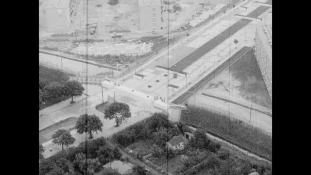 / aerial views of the rhine river / checkpoint along the river / looking down at buildings and trees along the riverbanks. berlin wall: rhine river... - 1962 stock videos & royalty-free footage