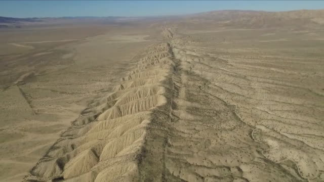 aerial views of the san andreas fault line - erdbeben stock-videos und b-roll-filmmaterial