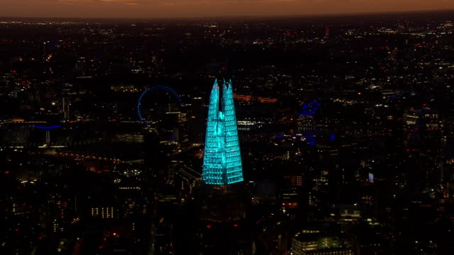aerial views of the shard lit up in support of the nhs and medical workers keeping us safe during the coronavirus epidemic on 2nd april 2020 london... - illuminated stock videos & royalty-free footage