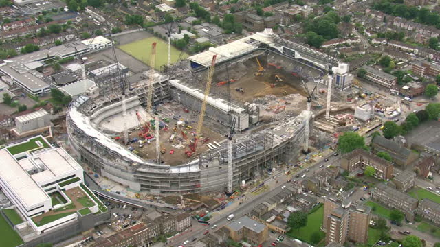Aerial views of Tottenham Hotspur Football Club stadium White Hart Lane being demolished and new stadium being built at the same time on 30th May...