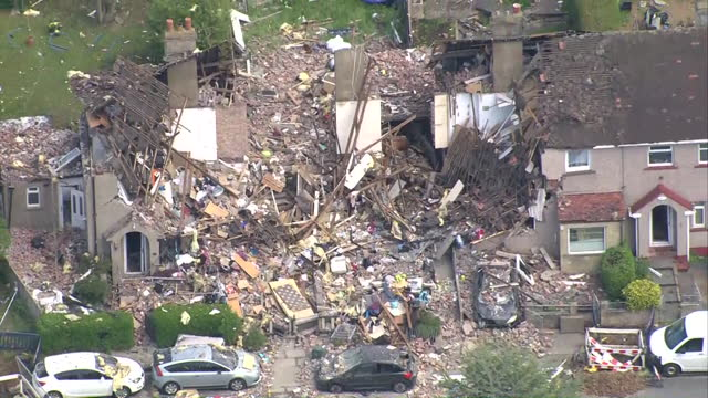 aerial views of two houses destroyed by a gas explosion in heysham - ruined stock videos & royalty-free footage