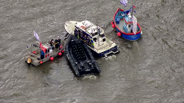 aerial views of vote leave vote remain campaign boats circling around each other and police boats observing them on the river thames pan to people... - 2016 european union referendum stock videos and b-roll footage