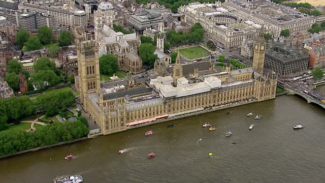 aerial views of vote leave vote remain campaign boats circling around each other in the river thames outside of the houses of parliament on june 15... - 2016 european union referendum stock videos and b-roll footage