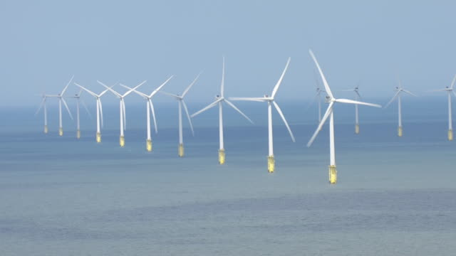 aerial views of wind turbines on an offshore wind farm on june 24 2019 at sea england - wind turbine stock videos & royalty-free footage