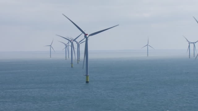 aerial views of wind turbines on an offshore wind farm on june 24 2019 at sea england - carbon footprint stock videos and b-roll footage