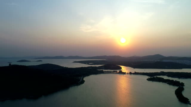 aerial views of wuxi lihu lake - wuxi stock videos and b-roll footage