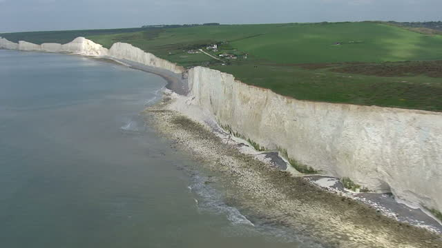 aerial views sussex heritage coast white cliffs seven sisters heading east to west with good views of belle tout lighthouse and debris rubble from... - east sussex stock videos & royalty-free footage