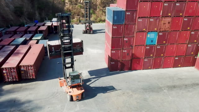 aerial view.shipping container loader truck transporting box. - pier stock videos & royalty-free footage
