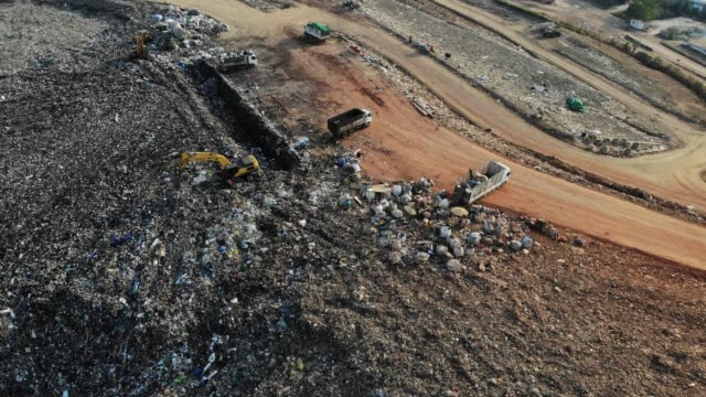 aerial view/waste pits, which are places to receive waste from the city to enter the disposal and sorting for recycling. - coal stock videos & royalty-free footage