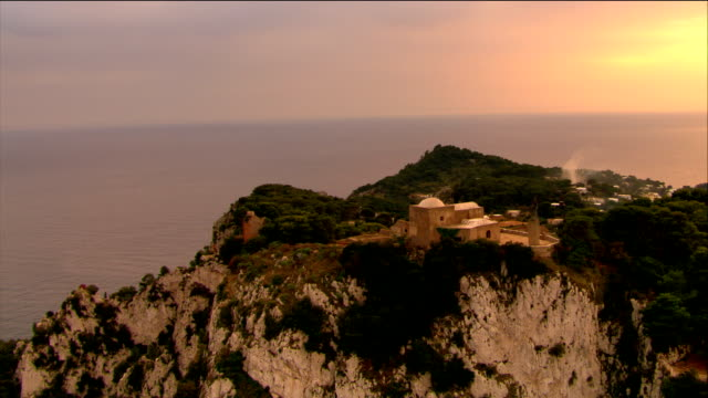 aerial villa jovis (palace of tiberius) on promontory of capri overlooking bay of naples / italy - mediterranean culture stock videos & royalty-free footage