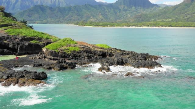aerial: volcanic rocks at the bottom of an island off oahu, oahu, hawaii - big island hawaii islands stock videos and b-roll footage
