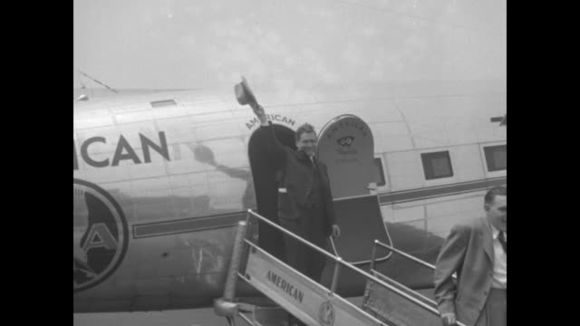 stockvideo's en b-roll-footage met aerial vultee aircraft plant / aerial crowd outside plant / politician wendell willkie waves as he walks down american airlines airplane stairs /... - plant stage