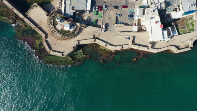 aerial: wall separating old city of acre from the sea - akko stock videos and b-roll footage
