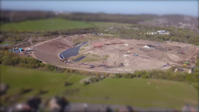 aerial walley's quarry landfill in silverdale, newcastle-under-lyme which is causing a terrible smell in the area due to increased levels of hydrogen... - quarry stock videos & royalty-free footage