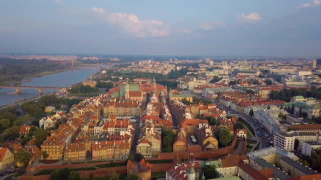 aerial / warsaw city center with vistula river - varsavia video stock e b–roll