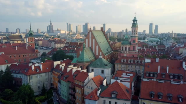aerial/ warsaw skyline and red roofs. skyscrapers in background - varsavia video stock e b–roll