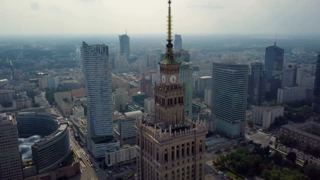 aerial / warsaw's business center: the palace of culture and science surrounded by skyscrapers. buildings, streets, traffic - warsaw stock videos & royalty-free footage