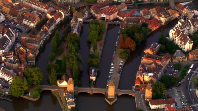 Aerial WS Watchtowers and Ponts Couverts over Ill River in late afternoon light / Strasbourg, Alsace, France