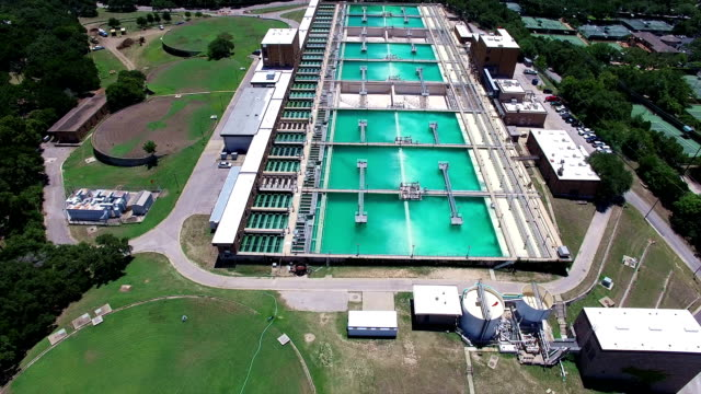 Aerial: Water Treatment Purification Plant Flying right over entire water cleaning factory