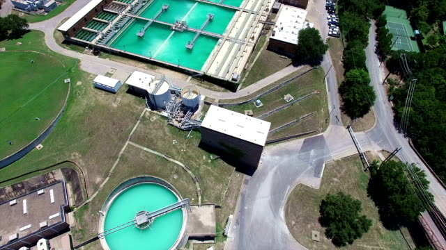 aerial: water treatment purification plant long extended version - purified water stock videos & royalty-free footage