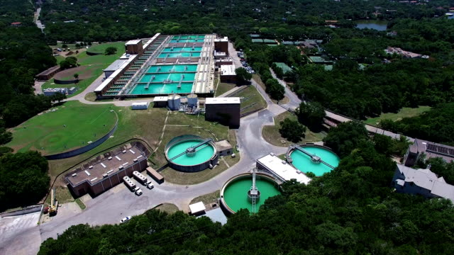 Aerial: Water Treatment Purification Plant lowering down