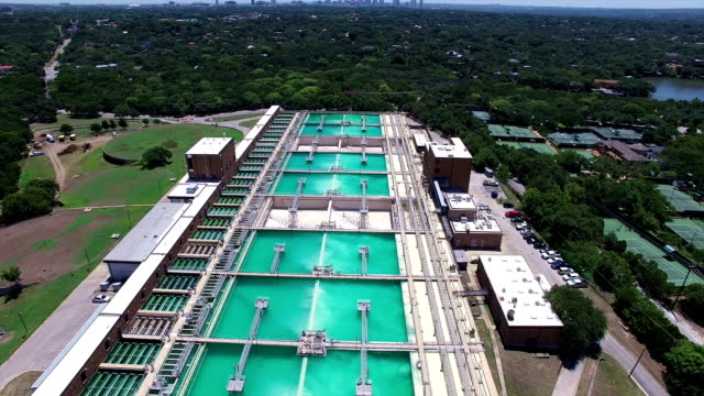 Aerial: Water Treatment Purification Plant short perfect fly over Austin Area Clean water treatment