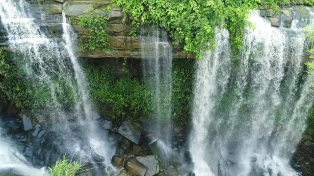 aerial waterfall man fah thailand - flowing water stock videos & royalty-free footage