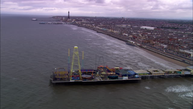 aerial waterfront and amusement pier/ blackpool, england - blackpool stock-videos und b-roll-filmmaterial