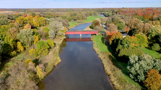 aerial west montrose covered bridge (kissing bridge) and grand river near kitchener, waterloo regional, canada - ontario canada stock videos & royalty-free footage