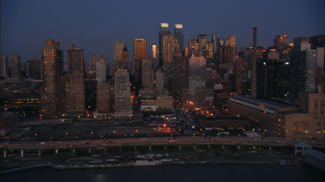 aerial ws west side highway with view of illuminated midtown buildings including time warner center, hearst tower, and worldwide plaza / manhattan, new york, new york, usa - time warner center stock videos & royalty-free footage