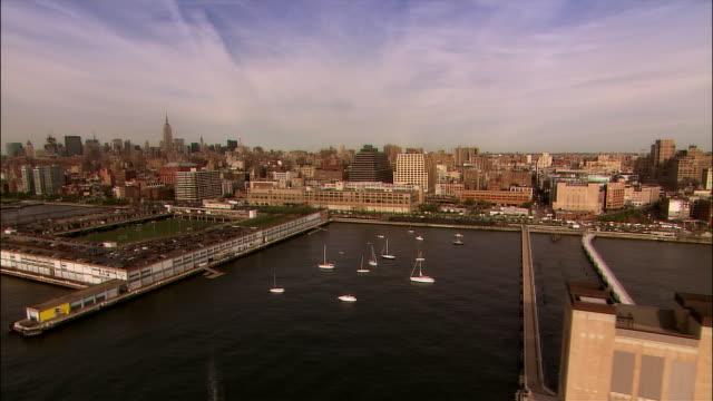 aerial west side of manhattan approaching midtown/ new york city - chelsea manhattan video stock e b–roll