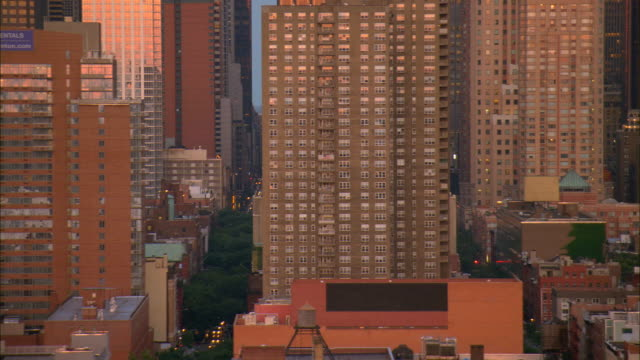 aerial ws west side streets in midtown with view of radio city music hall sign / manhattan, new york, new york, usa - radio city music hall stock videos & royalty-free footage