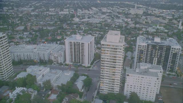stockvideo's en b-roll-footage met d/x (late afternoon) aerial westwood (1998); 2 views - westwood los angeles