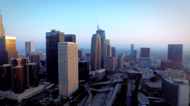 Aerial whip pan of downtown Los Angeles California at sunset