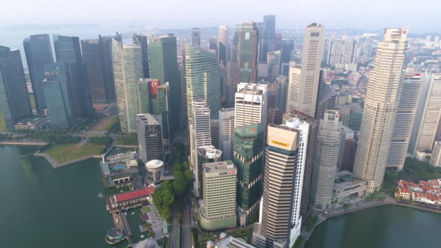 aerial wide cityscape view of skyline in singapore downtown cbd central - marina stock videos & royalty-free footage