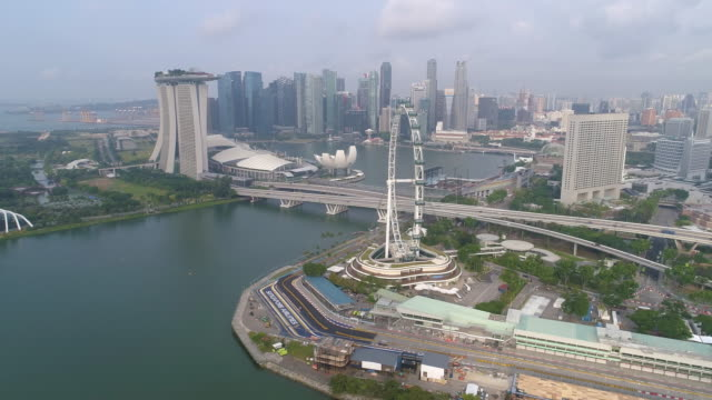 aerial wide cityscape view of skyline in singapore downtown cbd central - marina bay sands stock videos and b-roll footage