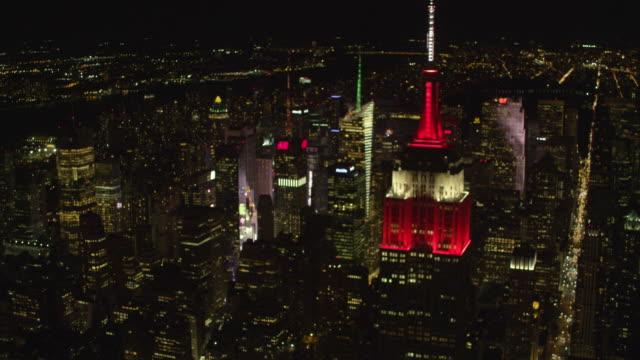 aerial wide empire state building red/white at night - 2014 stock videos and b-roll footage