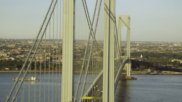 aerial wide fly-over staten island side verrazano-narrows bridge - staten island stock videos and b-roll footage